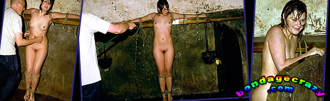 bondage crazy - naked siobahn is hosed with a cold water as the is tied up standing in the water and shivering